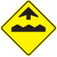 Pavement is bumpy and uneven ahead